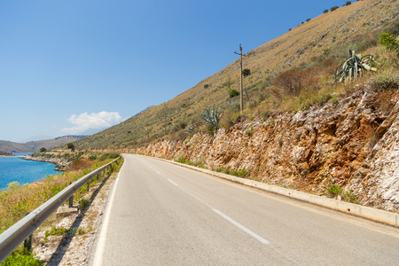view of the road along the Adriatic coast in Albania. Mountain in the background.