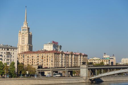 Moscow, Russia- 21 September 2014: View of the Borodinsky Bridge, steel plate girder bridge that spans Moscow River. Skyscraper in the background. Editorial