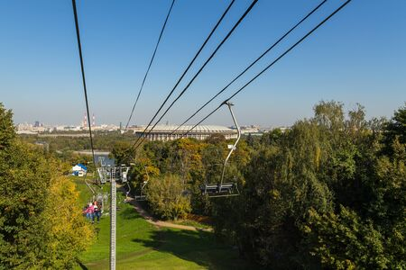 Moscow, Russia- 21 September 2014: Luzhniki Stadium, national and the largest football stadium of Russia. It is part of the Luzhniki Olympic Complex. Chairlift with passenger. 新聞圖片