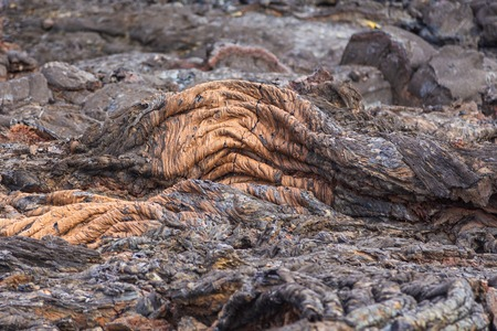 Grey, fresh lava field and glossy rocky land near Volcano Tolbachiskiy. Bizarre formations on the lava fields. Kamchatka Peninsula in the far east of Russia.