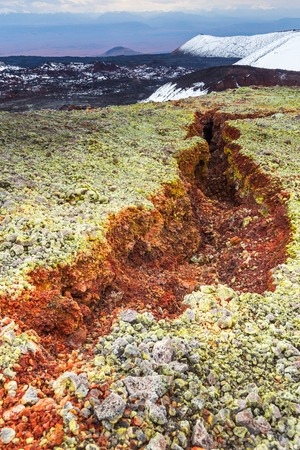 Volcanic landscape on the Kamchatka Peninsula in the far east of Russia. Green moss on black volcanic rock.