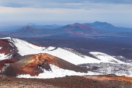 Volcanic landscape, massive, one of the volcanic complex on the Kamchatka Peninsula in the far east of Russia. Mountains covered with snow. Stock Photo