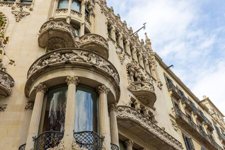 Barcelona, Spain- 10 November 2014: Facade of a modernist building at Passeig de Gracia, Eixample District. Building with rich decorations. New part of the city. Archivio Fotografico - 128214291