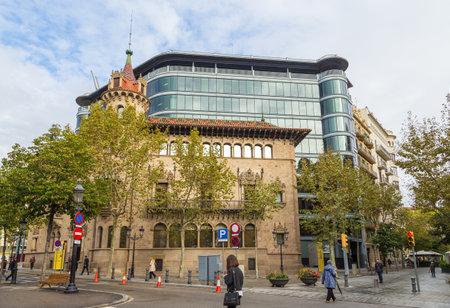Barcelona, Spain- 10 November 2014: View of the facade a city Office Building at Rambla de Catalunya. Diputacio de Barcelona - Can Serra. Glass, modern office building in the background. Editorial