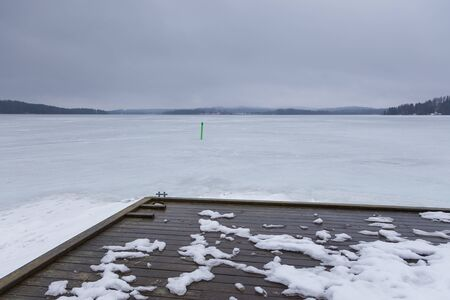 View of the frozen Iso Tilijarvi lake in Hollola. Winter landscape in Finland.