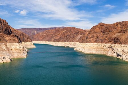 View of the Colorado River below Hoover Dam. High canyon rocks, Nevada, USA.