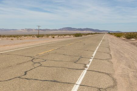 View of the legendary Route 66, National Trails Highway. California sideways. Mountain in the background. Ludlow, USA.
