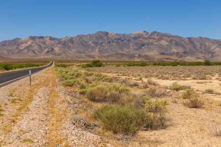 American wilderness, an empty state road. Around the mountain, Nevada, USA.