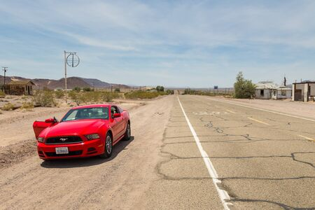 Route 66, Ludlow, California, USA- 30 May 2015: Red Ford Mustang on the National Trails Highway, Route 66.