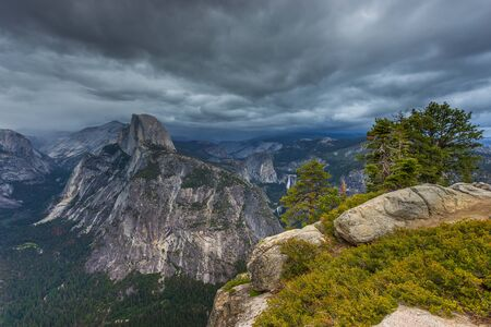 View of the Half Dome and Yosemite Valley from Washburn Point. Sierra Nevada mountain, the Yosemite National Park, California, USA.