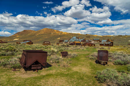 View of the Bodie, ghost town. Bodie State Historic Park. Abandoned wooden houses and Standard Consolidated Mining Company Stamp Mill, California, USA. Editöryel