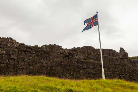 Thingvellir, Iceland- 22 August 2015: Icelandic flag on the mast at the historic site of the first parliament