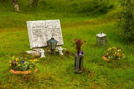 Thingvellir, Iceland- 22 August 2015: Book-shaped tomb at Thingvellir National Park cemetery.