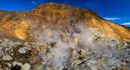 Geothermal area, hot steam, solfataras and hot gray mud cauldrons. Krisuvik, western Iceland. Reykjanesfolkvangur Peninsula.