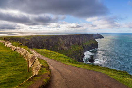 Aerial panorama of the scenic Cliffs of Moher in Ireland. This popular tourist attraction is situated in County Clare along the Wild Atlantic Way.