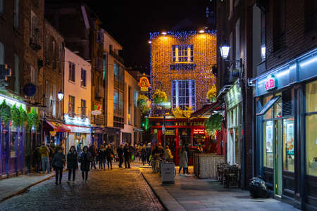 Dublin, Ireland- 08 November 2015: Nightlife at popular historical part of the city - Temple Bar quarter in Dublin, Ireland. The area is the location of many bars, pubs and restaurants.