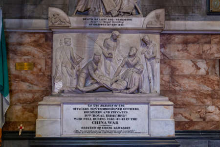 Dublin, Ireland - 09 November 2015: Tomb of Officers, Non-Commissioned Officers, drummers and Privates Who Fell in China War. Sculpture of figures in the Saint Patrick Cathedral, Dublin, Ireland. Редакционное