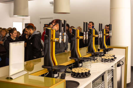 Dublin, Ireland - 09 November 2015: Beer tasting in the interior of Guinness store in Dublin. Guinness Storehouse is a tourist attraction at St. James Gate Brewery.