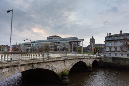 Dublin, Ireland- 09 November 2015: O Donovan Rossa Bridge over Liffey river in the evening. Road bridge joining Winetavern Street to Chancery Place. Editoriali