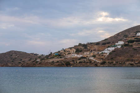 View of the buildings on the hill, Paralia Gialos, Ios Island, Greece. Sunset.