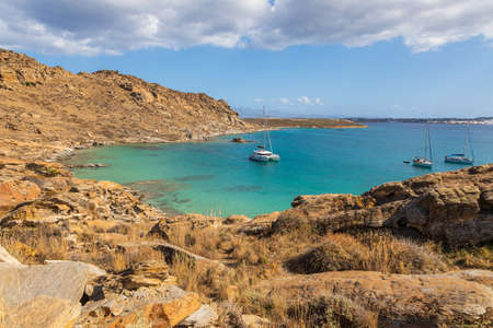 View of the rocky coast at Monasteri Beach. One of the most popular beaches on the island of Paros. Greece.