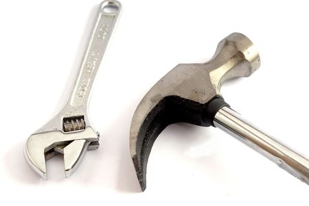 Adjustable wrench and hammer Stock Photo