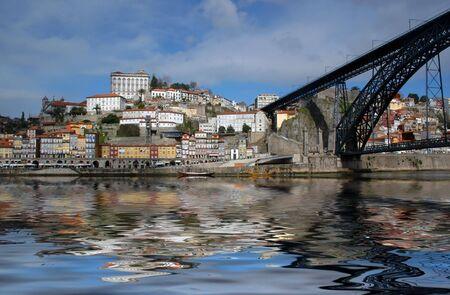 oporto city reflected on douro river