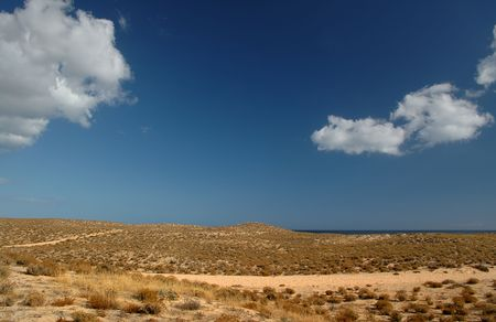 dunes and blue sky with clouds