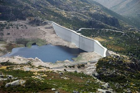 basin mountain: hydroelectric basin and dam situated in mountain area Stock Photo