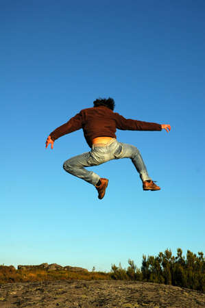 young man jump in the rock Stock Photo - 17073747