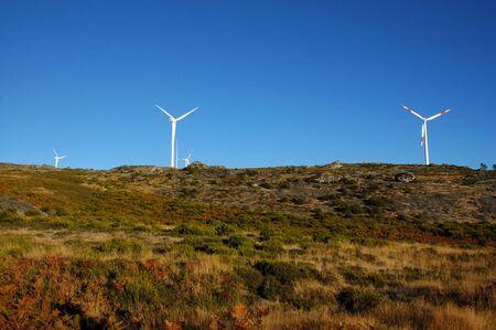 eolic: four eolic generators in a wind farm
