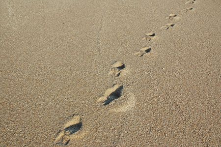 Footprints going over a sand dune Stock Photo - 17075099