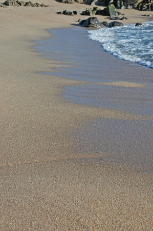 Footprints going over a sand dune Stock Photo - 17075043