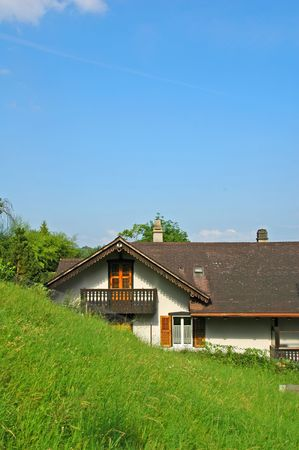 Traditional Swiss rural house in porrwntruy photo