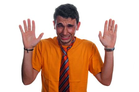 Frustrated man with orange tie and hand in the air