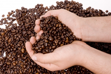 hands holding coffee making heart form isolated on white background Stock Photo - 17075750
