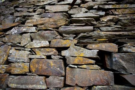 Sfondo fatto di un primo piano di un muro di pietra Archivio Fotografico