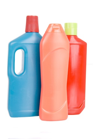 3 bottles of different detergents on white background