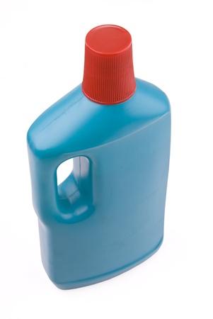 Blue plastic bottle of detergent on white background