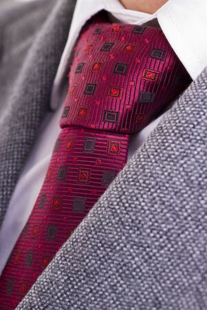 Closeup of formal business attire with necktie, shirt and jacket