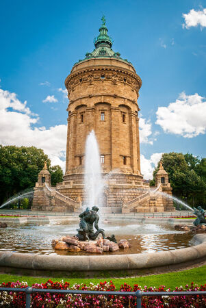 Water Tower in Mannheim with fountain and flowers on the foreground Stock Photo