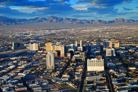 Las Vegas street Skyline aerial view with mountain and hotels on strip. photo