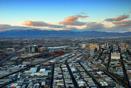 Las Vegas panorama at sunset with mountain, highway, street and luxury hotels. Stock Photo - 6791109