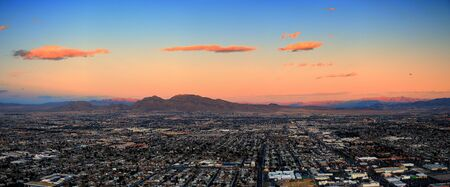 Las Vegas City Skyline panorama with sunset, mountain, luxury hotels and streets. photo
