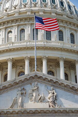 capitol building: US national flag flying in front of US capitol Building in Washington DC