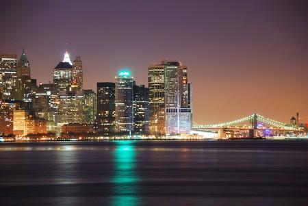 Hudson River with Manhattan, New York City skyline at night.
