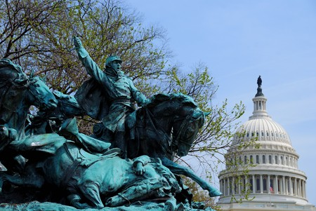 The Age of Hero of Civil War Memorial and Capitol Hill Building dome in Washington DC photo