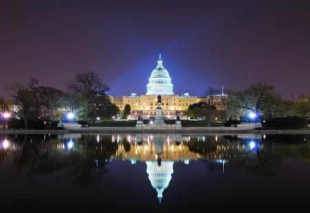 Capitol hill building at night illuminated with light with lake reflection, Washington DC.  photo