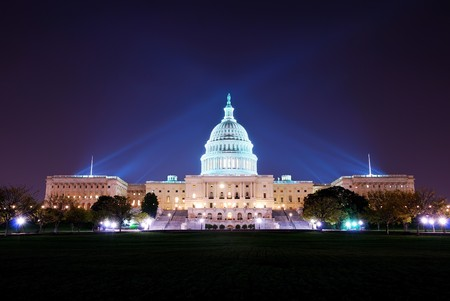 Capitol hill building at night illuminated with light, Washington DC.  스톡 콘텐츠