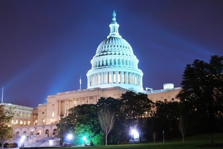 us capitol: Capitol hill building at night illuminated with light, Washington DC.  Stock Photo
